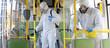 canvas print picture - HazMat team in protective suits decontaminating public transport, bus interior during virus outbreak
