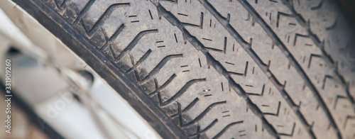 Fotografie, Tablou Tires from the car, worn summer tires. Selective focus.