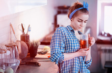 A Cute Young Girl In The Kitchen Prepares Food