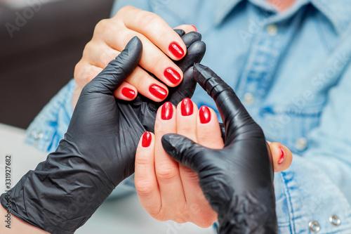 Slika na platnu Red nails of woman.
