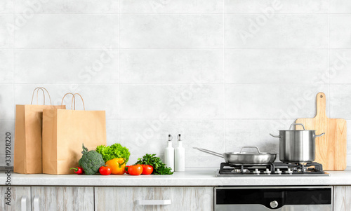 Contemporary kitchen front view, fresh vegetables just bought in a supermarket a Poster Mural XXL