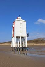 Lighthouse On Burnam-on-Sea Beach At Low Tide