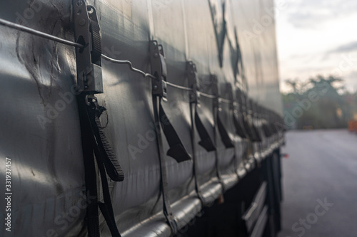 attaching the awning of the cargo trailer closeup Wallpaper Mural