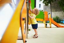 Adorable Toddler Girl On Playg...