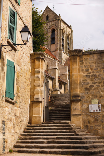 stone staircase in the monastery. Auvers sur voise. France Canvas Print