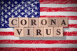 Hand drawn flag of United States of America with wooden cubes spelling coronavirus on it. 2019 - 2020 Novel Coronavirus (2019-nCoV) concept, for an outbreak occurs in USA.