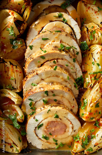 Fototapeta Pork loin  roulade stuffed with sausage with addition onion, herbs and aromatic