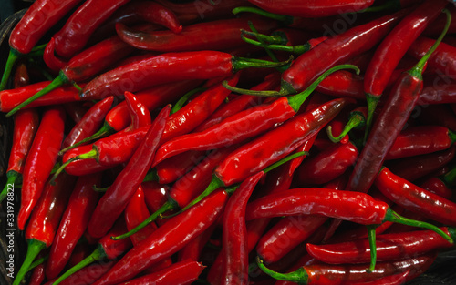 Fototapety, obrazy: Plenty of fresh red peppers on a counter in a market