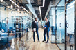 Multiethnic partners having conversation in office corridor