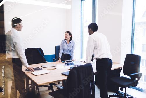 Fototapeta Multiracial coworkers talking in office obraz na płótnie