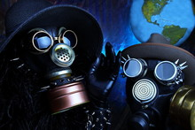 Gas Mask And Planet Earth. Virus, Pollution And Chemical Protection Concept.Selective Focus, Dark Key Image.