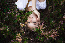 Young Girl Lying In Grass And ...