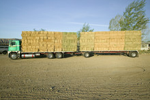 Parked Truck Loaded With Neatly Stacked Hay Bales Near Cuyama, California