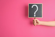 Woman Holding Blackboard With Question Mark On Pink Background, Closeup. Space For Text
