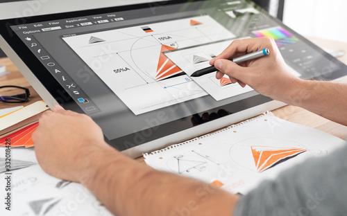 Obraz na plátně Graphic designer drawing sketches logo design.