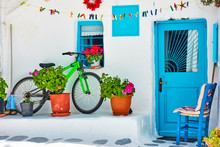 Street With Whitewashed House And Bicycle In Mykonos