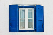 Window With Blue Shutters In Mykonos