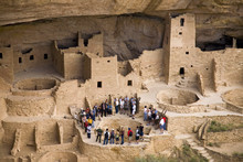 Tourists Viewing Kiva At Cliff Palace Cliff Dwelling Indian Ruin, The Largest In North America, Mesa Verde National Park, Southwestern Colorado