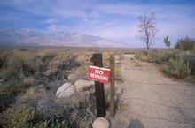 No Trespassing Sign At Dirt Ro...