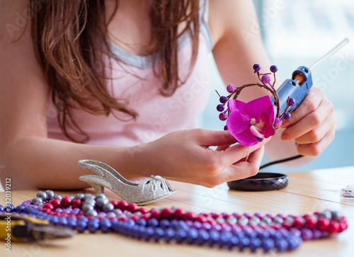Woman making jewelry at home Wallpaper Mural
