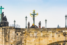 Prague, Czech Republic - March 19, 2020. Statues Of Charles Bridge Without Tourist During Covid-19 Travel Ban
