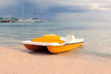 Yellow Boat On The Beach