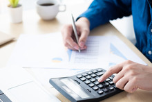 Businessman Is Inspecting And Checking The Business Reports Graphs To Audit The Financial Reports By Calculating The Results. Analyzing The Revenue And Auditing The Budget Concept.