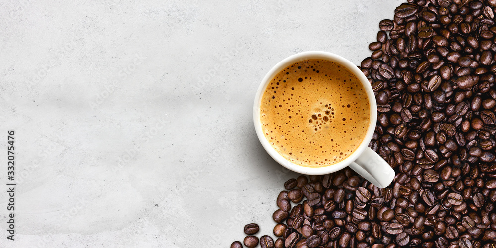 Fototapeta cup of coffee and bean on cement table background
