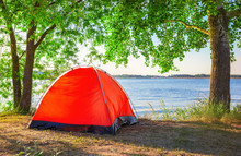 Red Tourist Tent On Lake In Summer