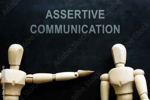 Assertive communication phrase and two wooden figures. Wallpaper Mural