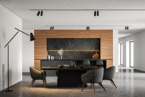 Fototapeta White kitchen with bar and dining table obraz