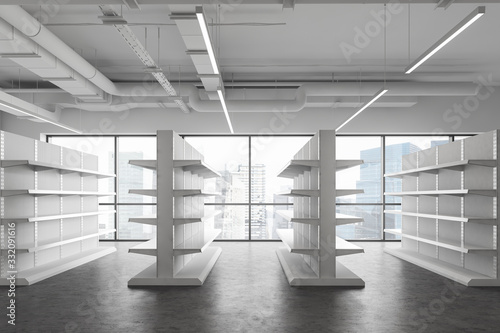 Fototapeta Empty shelves in white supermarket, side view obraz