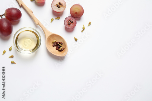 Valokuva Composition with natural grape seed oil on white background, top view