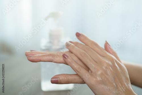 Cuadros en Lienzo Female hands using wash hand sanitizer gel pump dispenser