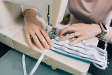 Woman Hands Using The Sewing M...