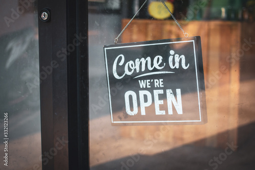 A business sign that says 'Come in We're Open'. Tablou Canvas