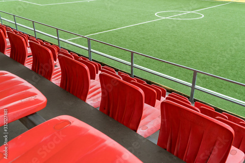 Foto Empty rows with red  seats on a football stadium