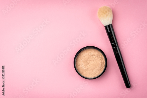 Makeup brush and powder on pink background. Canvas Print