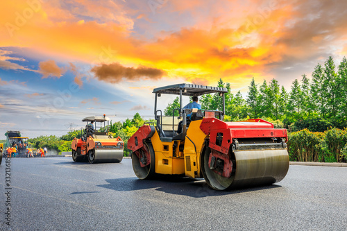 Construction site is laying new asphalt road pavement,road construction workers and road construction machinery scene Canvas Print