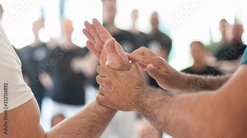 Martial arts instructor showing hand bar lever and leverage Canvas Print