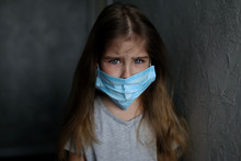 An Excited Child Wearing A Face Shield To Prevent Viral Infection Or Contamination. Quarantine