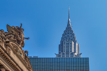 Statue Of Grand Central Terminal And Chrysler Buliding At Blue Sky In New York, US From Low Perspective.