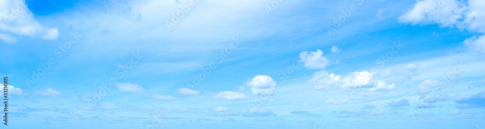 Fototapeta Blue sky with small clouds in springtime in Sardinia
