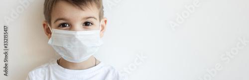 Obraz Concept of coronavirus quarantine. Child in mask . Protection against virus, infection. Health. Medical virus poster design - fototapety do salonu