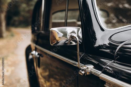 Black retro car in nature