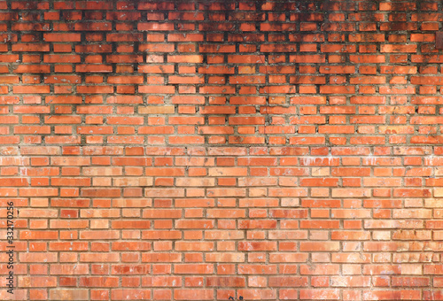 big old wet wall with water dripping from up to down on the orange bricks - back Fototapet