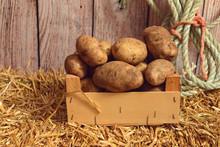Closeup Russet Potatoes In Woo...