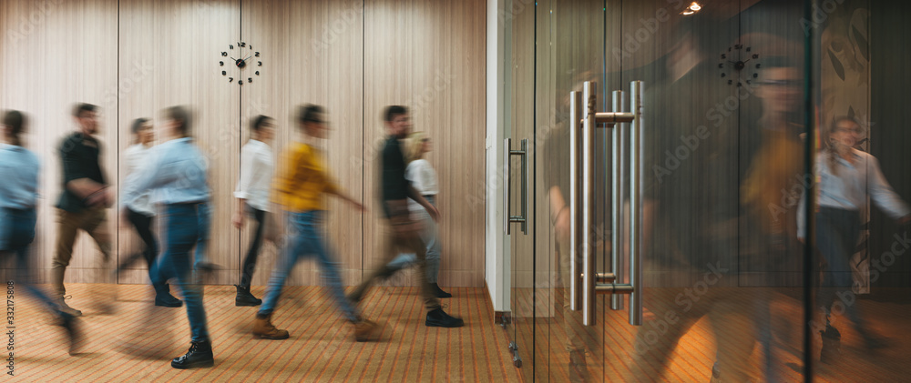 Fototapeta Group of office people walking at office open space. Team of business employees at coworking center. People at motion blur. Concept working at action