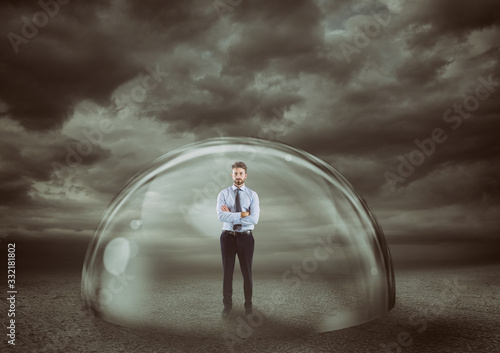 Businessman safely inside a shield dome during a storm that protects him Fototapet