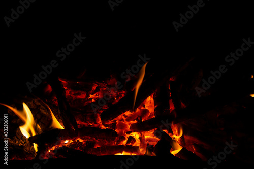 Red coals with fire on a black background Canvas Print